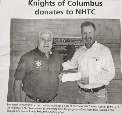 Knights donate contributions from the Tootsie Roll drive to the NHTC